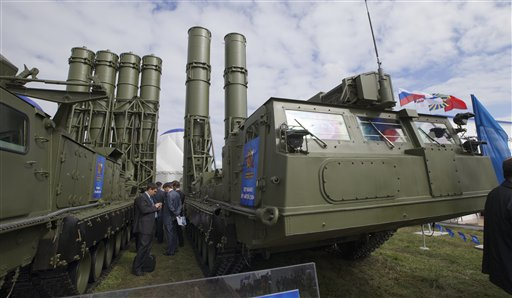 In this Aug. 27, 2013, photo, Russian air defense missile systems are displayed at the opening of an air show in Zhukovsky outside Moscow. Russia could expand arms sales to Iran and revise the terms of U.S. military transit to Afghanistan if Washington launches a strike on Syria, a senior Russian lawmaker said Wednesday.