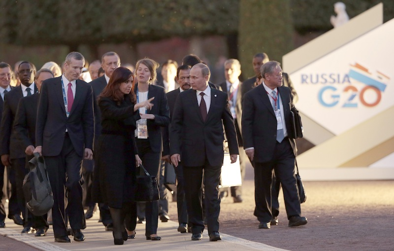 Russia's President Vladimir Putin, front center right, speaks with Argentina's President Cristina Fernandez de Kirchner, front center left, as they walk with other G-20 leaders toward a dinner at the Peterhof Palace in St. Petersburg, Russia on Thursday, Sept. 5, 2013. The threat of missiles over the Mediterranean is weighing on world leaders meeting on the shores of the Baltic this week, and eclipsing economic battles that usually dominate when the G-20 world economies meet. (AP Photo/Ivan Sekretarev) G20;G-20;Group of 20