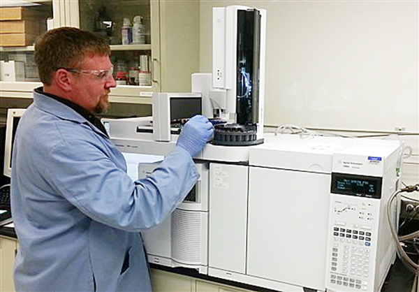In this image provided by the Department of Energy, chemist Brian Dockendorff works on a mass spectrometer at the Pacific Northwest National Laboratory in Richland, Wash. Carlos Fraga, a chemist at the lab who specializes in nerve agent forensics, says the numbers 99-125-81 are sarin's fingerprint.