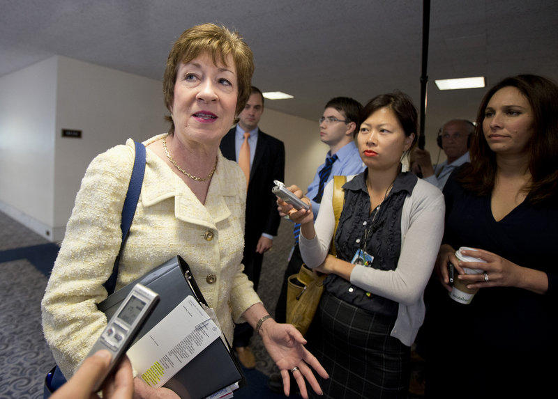 Senate Intelligence Committee member Sen. Susan Collins, R-Maine talks to reporters on Capitol Hill in Washington, Thursday, Sept. 5, 2013, as she arrives for a closed-door briefing on Syria. (AP Photo/Manuel Balce Ceneta)