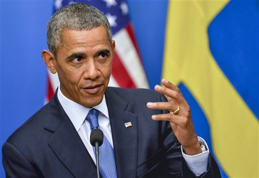 U.S. President Barack Obama fields questions during a press conference with the Swedish prime minister at the chancellery Rosenbad in Stockholm, Sweden, on Wednesday.