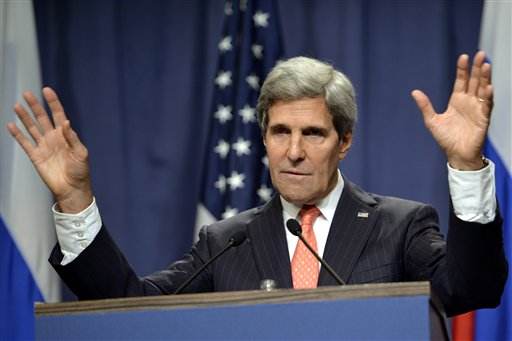 U.S. Secretary of State John Kerry addresses reporters in Geneva, Switzerland, Saturday after he and Russian Foreign Minister Sergei Lavrov announced their agreement on a framework for Syria to destroy all of its chemical weapons.