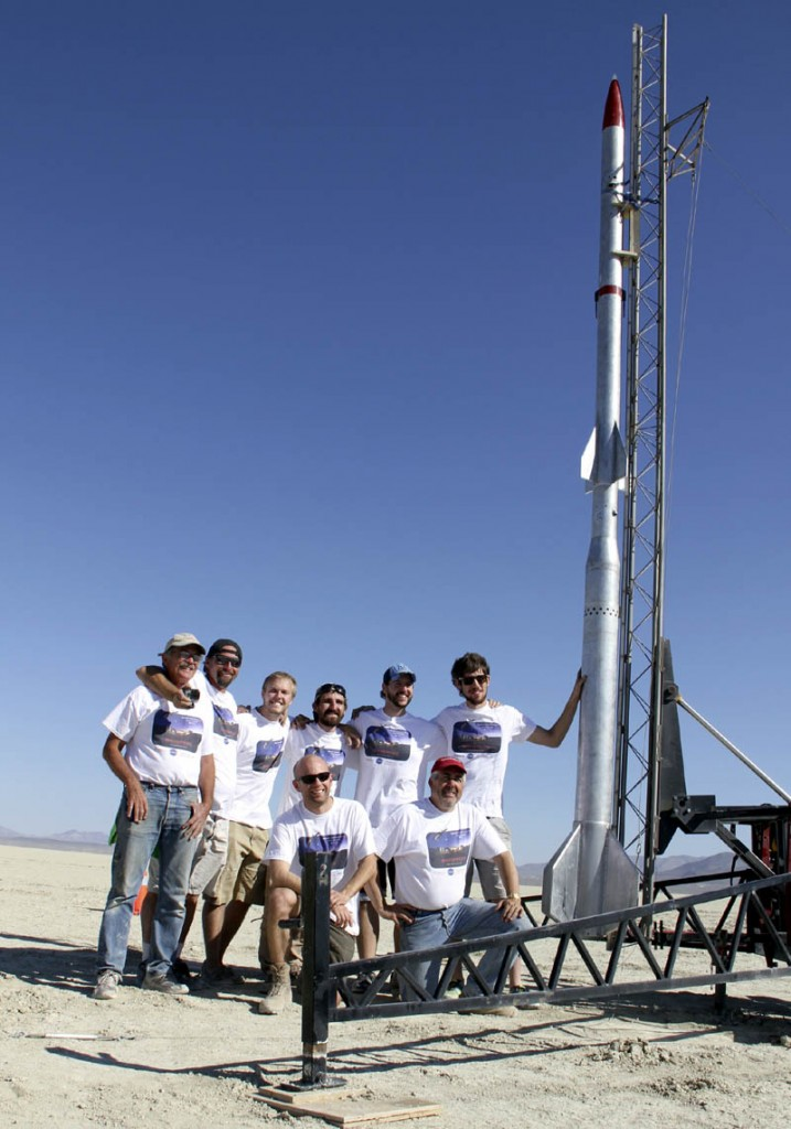 The team and rocket designed, built and launched by former and current University of Maine students, including Winslow's Michael Ostremecky, are pictured in Nevada prior to the rocket's launch on Monday. Standing, left to right, are Dick Matthews, Fritz Sexton, Gerard Desjardins, Ostremecky, Josh Mueller and Luke Saindon. Kneeling are Charles Kennedy, left, and Thomas M. Atchison.