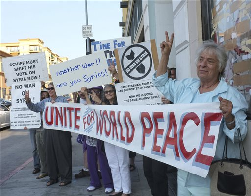 Anti-war activists rally for peace in Los Angeles last week. A breakthrough agreement on the destruction of Syrian chemical weapons was announced by the U.S. and Russia early Saturday, averting a military strike for the time being.