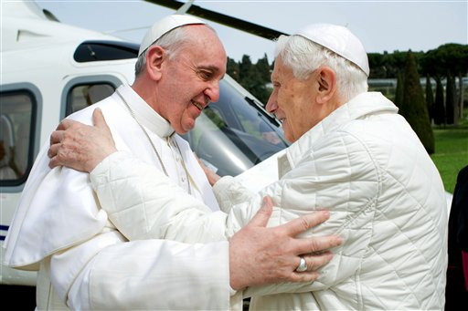 In this March 23, 2013, photo provided by the Vatican paper L'Osservatore Romano, Pope Francis, left, meets Pope emeritus Benedict XVI in Castel Gandolfo.