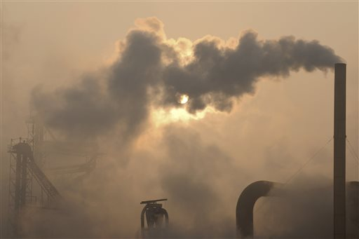 "Smoke pours from a chimney at a cement plant in Binzhou city, in eastern China's Shandong province. Scientists from around the world have gathered in Stockholm for a meeting of a U.N. panel on climate change and will probably issue a report saying it is ""extremely likely"" that humans are mostly to blame for temperatures that have climbed since 1951."