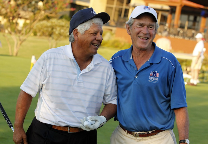 In this Sept. 26, 2013, photo, Lee Trevino and former president George W. Bush laugh prior to the Bush Center Warrior Open golf pro-am tournament for wounded veterans at the Las Colinas Country Club in Irving, Texas.