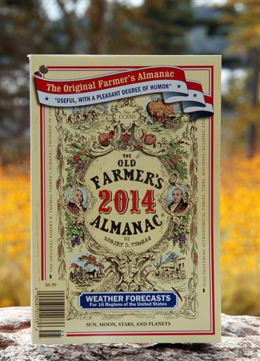 The 2014 edition of the Old Farmer's Almanac sits on a stone wall in New London, N.H., Monday, Sept. 9, 2013. Believed to be the oldest continuously published periodical in North America, the 222 edition is predicting that a drop in solar activity and a change in ocean patterns point to colder-than-average temperatures and higher-than-average snowfall totals in the United States. (AP Photo/Jim Cole)