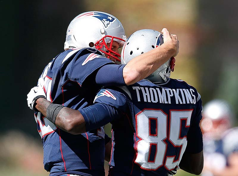 Patriots QB Tom Brady, left, celebrates his touchdown pass to wide receiver Kenbrell Thompkins in the first half Sunday at Foxborough, Mass. NFLACTION13;