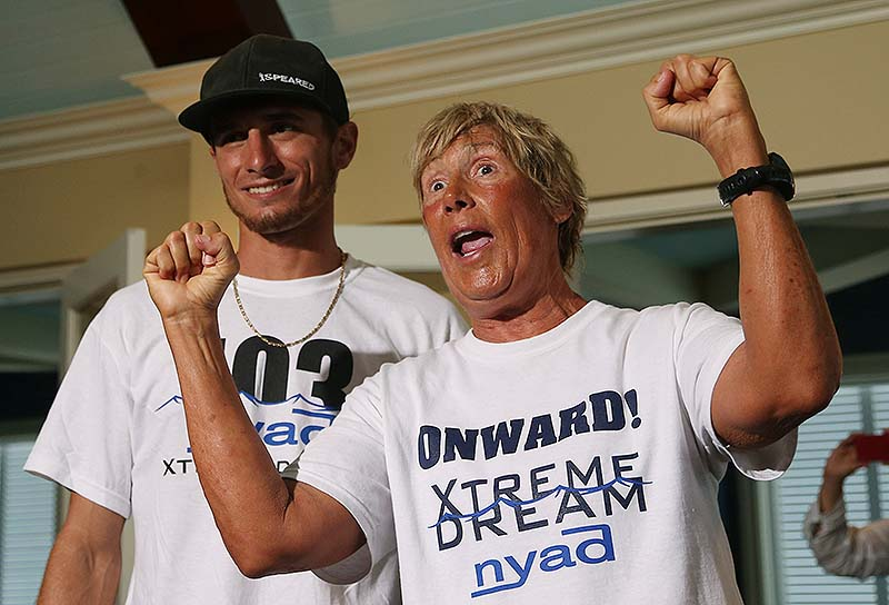 Diana Nyad, right, and one her shark divers, Niko Gazzace, celebrate her record-setting swim from Cuba to Florida, talking to the media during a press conference in Key West, Fla., last Tuesday.