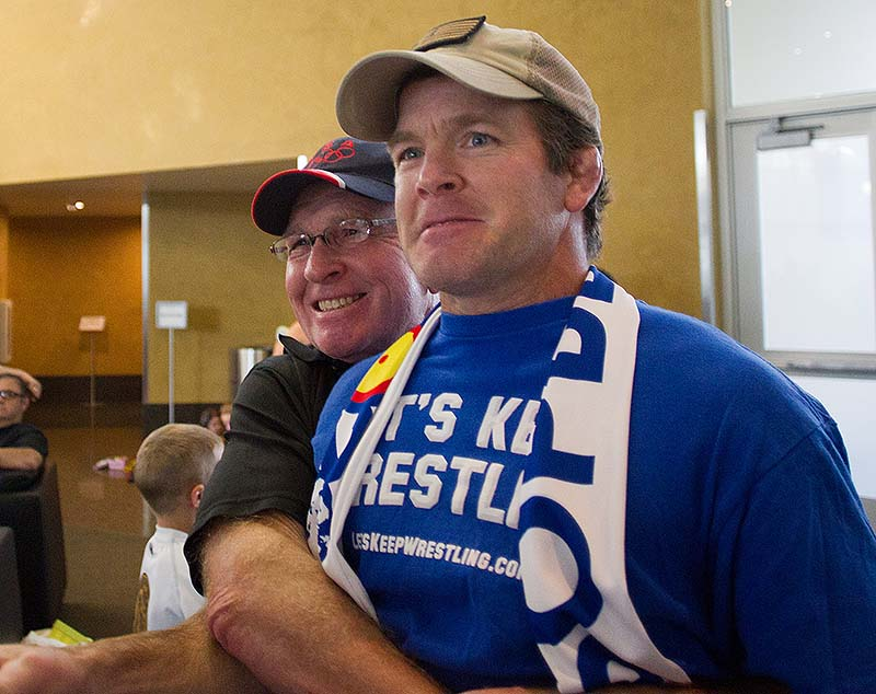 Wrestling legend Dan Gable celebrates with Iowa associate head coach Terry Brands after the International Olympic Committee voted, in a meeting in Buenos Aires, Argentina, to reinstate wrestling for the 2020 Olympics on Sunday.