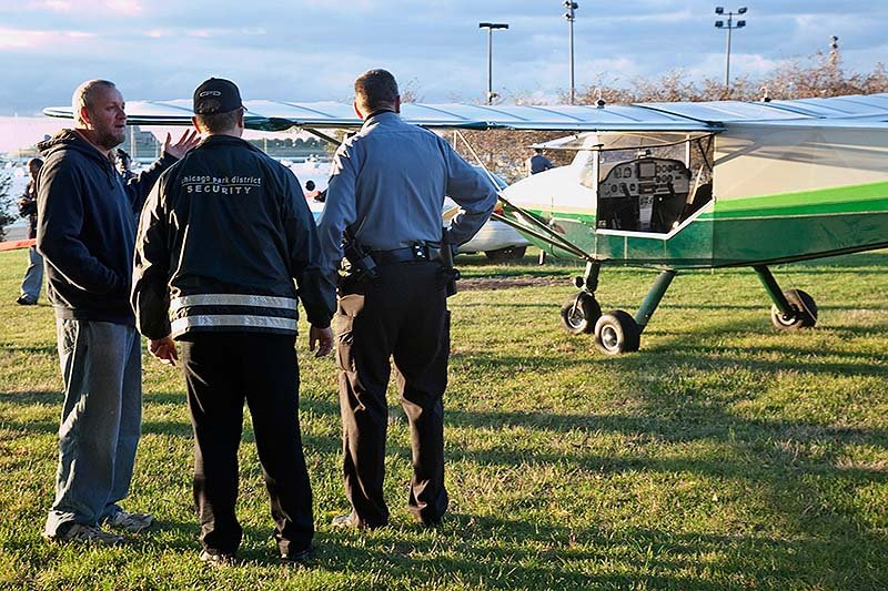 Pilot John Pederson, left, 51, landed his single-engine plane near Lake Shore Drive in Chicago early Sunday in an emergency landing because of mechanical issues. He landed in the northbound lanes of Lake Shore Drive near Grant Park, authorities said. Chicago police said no one was injured.