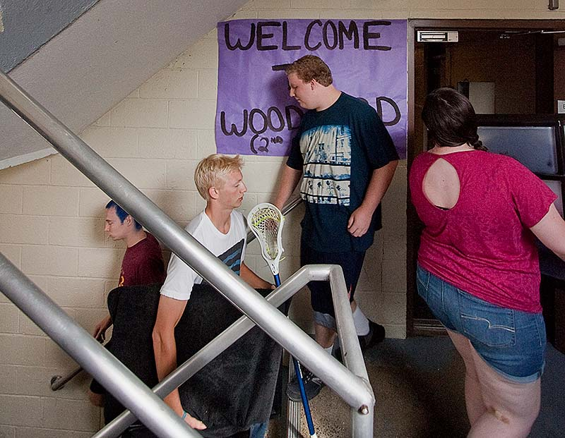 Parents and siblings help move incoming freshman into Woodward Hall at USM in Gorham on Sunday.