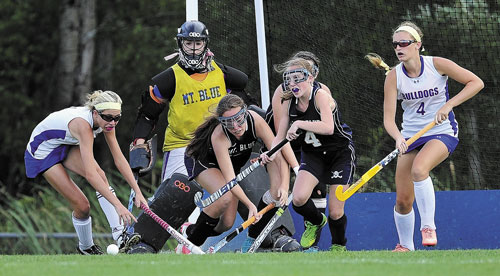 FIGHT IS ON: Lawrence High School's Hallee Parlin, far left, and McKenna Rogers, right, battle for a rebound with Mt. Blue defenders Taylor Hollingsworth, left center, and Leah St. Laurent, right center, during a game Thursday in Fairfield. Mt. Blue goalie Rileigh Blanchet watches the action.