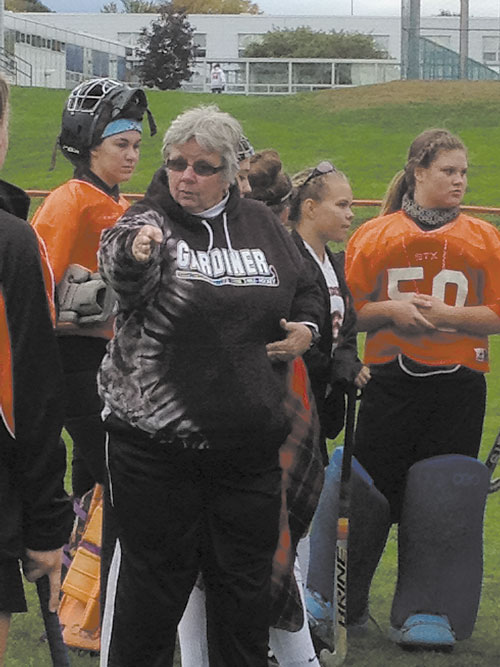 LEADING THE WAY: Gardiner field hockey coach Moe McNally, shown instructing a player at halftime, won her 400th career game Tuesday as the Tigers defeated Erskine, 4-0. McNally has been coaching Gardiner since 1979. Behind McNally are Emalee Couture, Emily Malinowski and Kaylin Mansir.