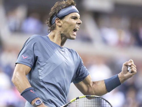 CHAMP: Rafael Nadal reacts after a point against Novak Djokovic during the men's singles final of the U.S. Open on Monday in New York. Nadal won 6-2, 3-6, 6-4, 6-1 for his 13th Grand Slam title.