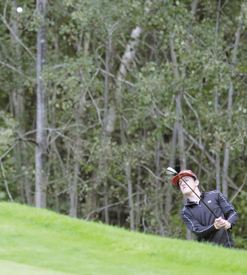 BLAST: Maranacook Community School's Luke Ruffing hits a ball onto the green Monday during a golf match against Mt. Blue High School at the Augusta Country Club in Manchester. Ruffing shot a 40 to share medalist honors with teammate Matt Delmar. The Black Bears won 175-227.