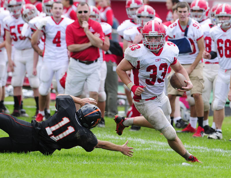 JUST OUT OF REACH: Brewer defensive back Dan Davis dives and misses Cony's Reid Shostak during a game Saturday at Alumni Field in Augusta.