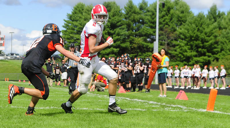 Staff photo by Joe Phelan HE'S IN: Cony wide receiver Mitchell Bonenfant scores a touchdown on a pass from Ben Lucas as Brewer defensive back Austin Pagnozzi, left, tries to stop him Saturday at Alumni Field in Augusta.