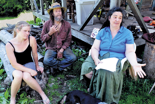 In this file photo from July 15, abutting landowners, from left, Elizabeth Smedberg and Harry and Cindy Brown, were expressing their concern about a proposed cellphone tower on Abijah Hill Road in Starks. Cindy Brown has since been charged with assault for allegedly spitting on a selectman.
