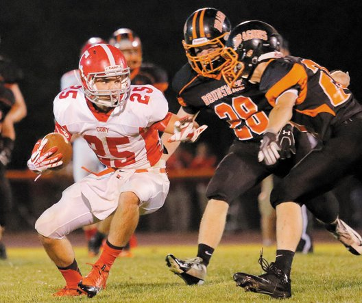 Cony's Tayler Carrier tries to make a move around Brunswick defenders Will Bessey, center, and Bailey Caparratto on Friday in Brunswick.