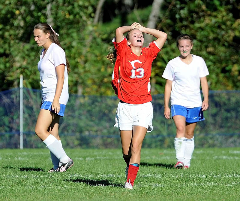 ALL RIGHT: Cony High School's Anna Brannigan, center, celebrates a goal during the Rams' 7-3 win over Messalonskee on Thursday at Messalonskee High School in Oakland.