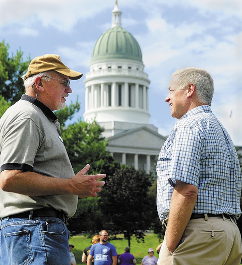 Charlie Conley, left, of Waterville, chats with Congressman Mike Michaud during the annual Central Maine Labor Council Annual Labor Day Picnic on Sunday at Capitol Park in Augusta.