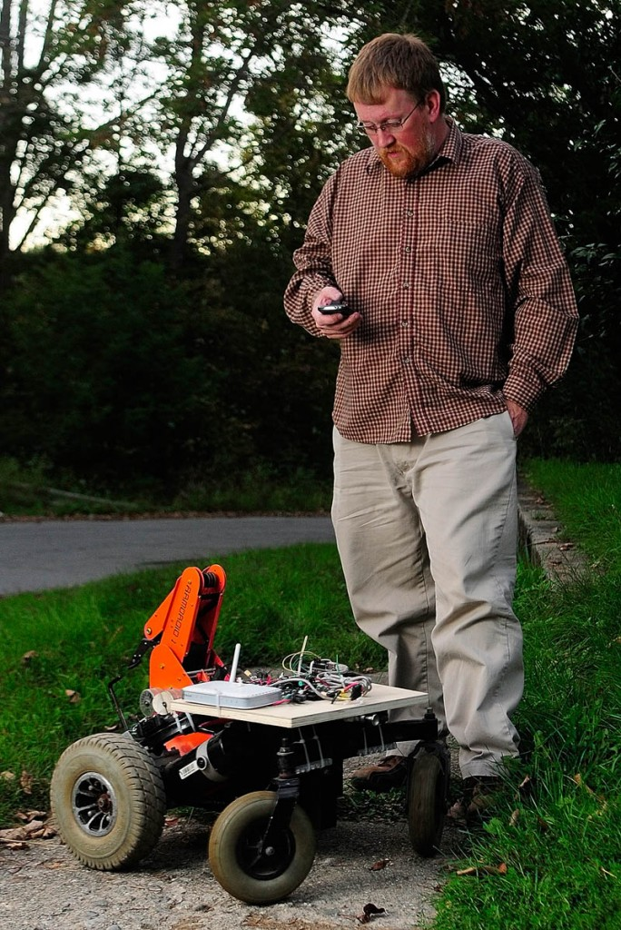 Paul Fowlerl uses his cellphone on Sept. 17 to operate a robot he created in Gardiner.