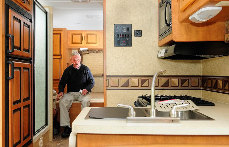 Chris Harnish talks about his 30-foot motor home during an interview Thursday in Augusta. He plans to leave the city in the RV on Oct. 10, on a five-month journey south and west to find the perfect retirement location.