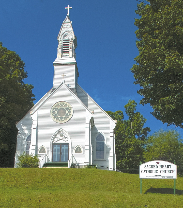 This photo taken on Thursday shows Sacred Heart Catholic Church in Hallowell. The City Council tonight urged the Catholic diocese to keep the church open and offered its assistance.