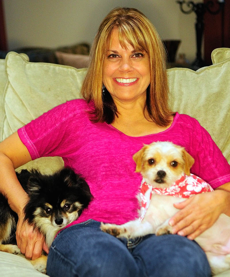 Stephanie Towle and her dogs Sophia Loren, left, and Murphy, sit on the couch on Saturday at her Chelsea home. Towle recently adopted Murphy through Puppy Love Inc., a rescue group that brought him to Maine from Louisiana.