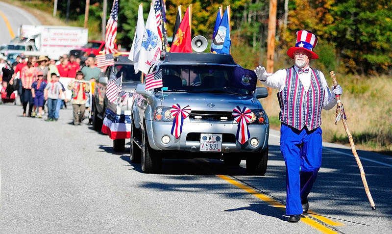 Willie Danforth, from the Franco-American War Veterans Post 31 in Lewiston and dressed as Uncle Sam, leads the 10th annual Manchester Apple Festival parade on Saturday on Route 17 in Manchester. The parade route was about 1 1/2 miles long, starting at Worthing Road and going to the Town Office. Other events at the festival included a 5k road race, pie eating contest, live music and a fireworks show.