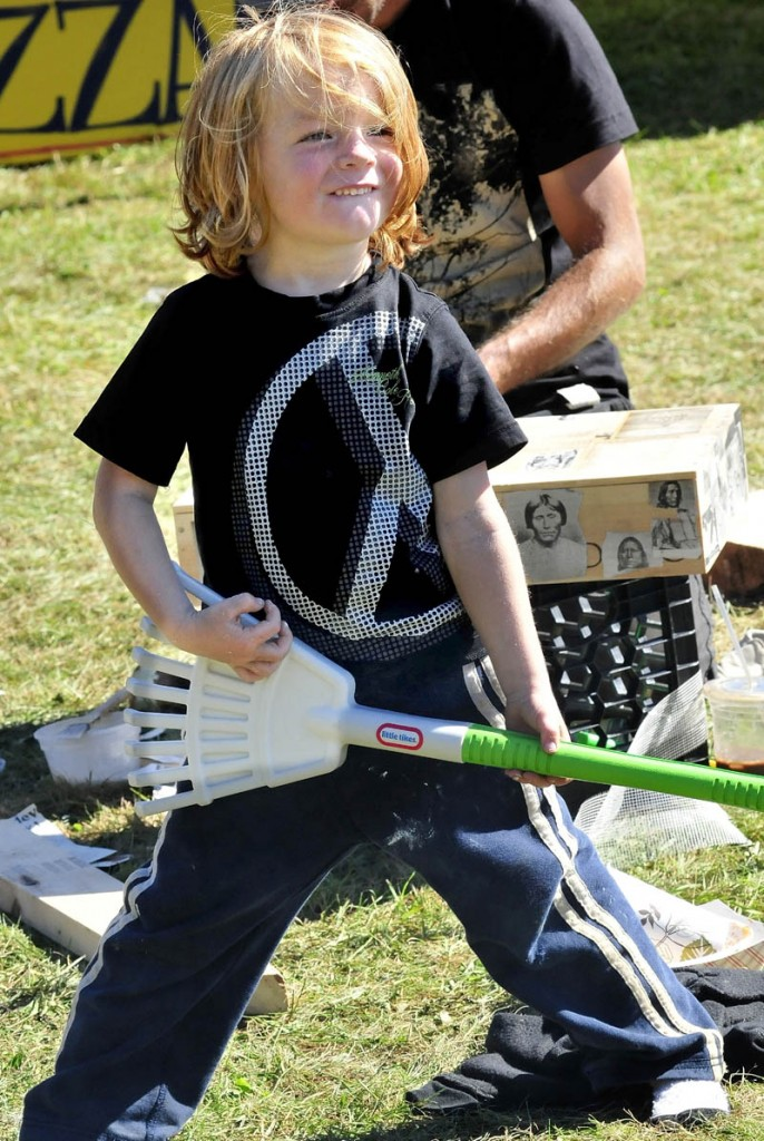 Aiden Henderson, of Portland, does an air rake as a band played during the Great North Fest in Norridgewock today.