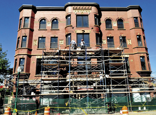Workers perform masonry and install windows on the Gerald Hotel in Fairfield on Sept. 9.