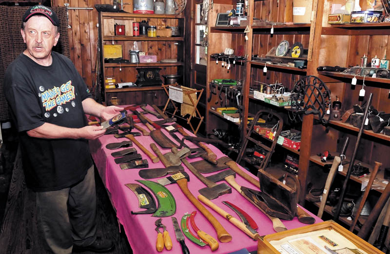 Howard Hardy speaks inside his shop in Hinckley, about his large collection of old axes and cutting tools manufactured by former Oakland tool companies.