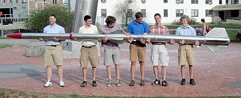 Team Ursa with the rocket they plan to send about 35 miles into the atomosphere. From left to right are Josh Mueller, of Cannon Falls, Ryan Means, of York, Luke Saindon, of Deer Isle, Alex Morrow, of Washburn, Robert Miller, of Portland and Gerard Desjardins, of Mapleton, Winslow resident Michael Ostromecky is not pictured.