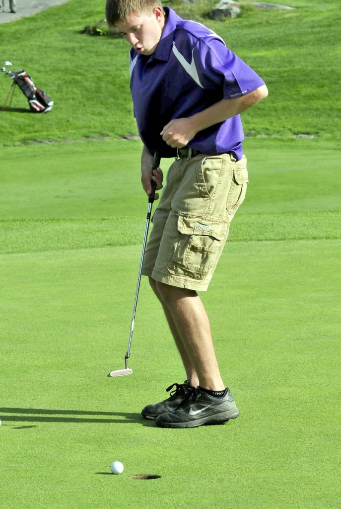 GET IN THE HOLE: Waterville's C.J. Gaunce tries to coax his ball into the hole in a match against Messalonskee on Monday at Belgrade Lakes Golf Course in Belgrade. The shot came up just short. Gaunce finished with a 57.
