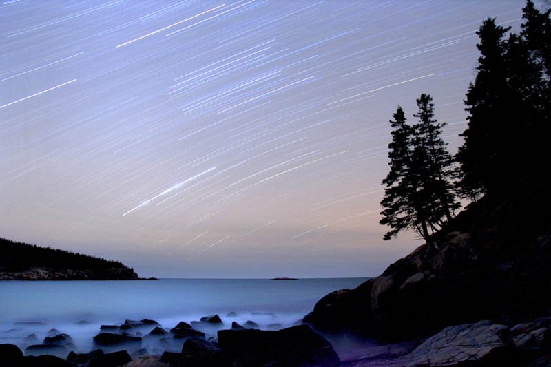 In this 2006 file photo, stars streak across the sky in a 75-minute time-exposure at Acadia National Park. The star-filled night skies are being celebrated during the fifth annual Acadia Night Sky Festival which began Thursday, Sept. 26, 2013 and runs through Sunday.