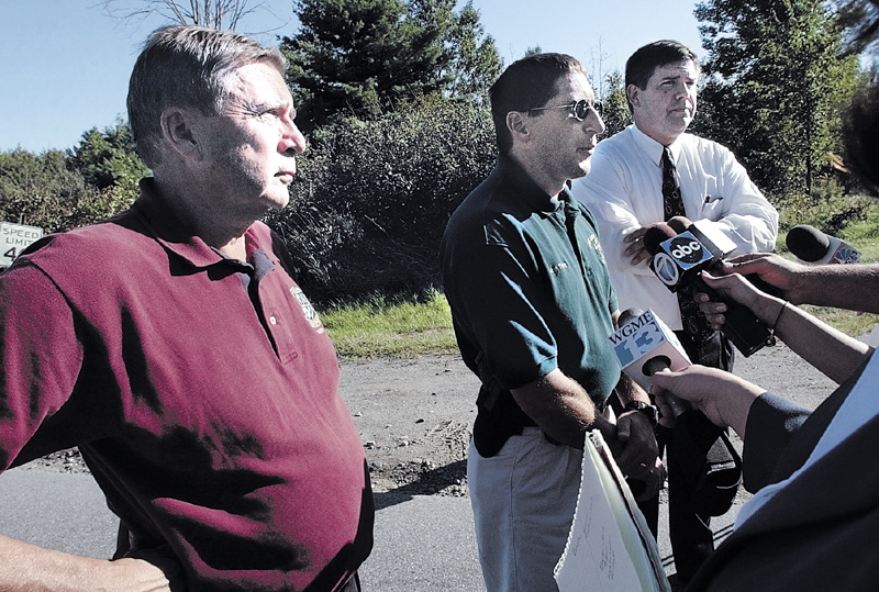 Police discuss details following the discovery of the body of Colby College student Dawn Rossignol along the Rice Rips Road in Oakland on Sept. 17, 2003. From left are then-Waterville Police Chief John Morris, Oakland Police Chief Mike Tracy and Maine State Police Detective Timothy Doyle.