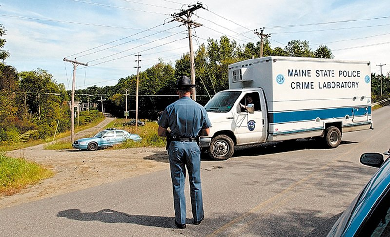 State police technicians pull into the Rice Rips Hydroelectric Project in Oakland on Sept. 17, 2003, where Colby College senior Dawn Rossignol's body was found. jim evans photo Published: No Published Caption
