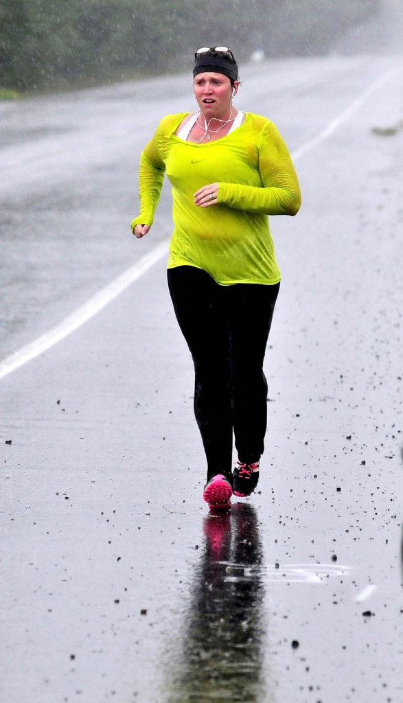 Jana White was soaked after running in a downpour through Norridgewock on a rainy Labor Day. Asked about the running conditions, White said, matter-of-factly,