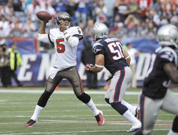 GET AFTER IT: Tampa Bay Buccaneers quarterback Josh Freeman (5) tries to throw a pass as New England defensive end Rob Ninkovich chases him during the Patriots' 23-3 win Sunday in Foxborough, Mass. Ninkovich signed a three-year extension worth more than $15 million.