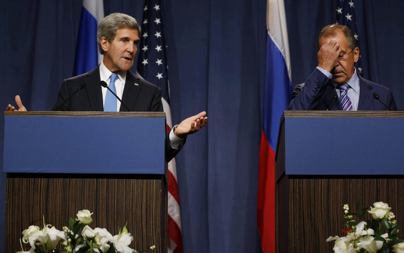 U.S. Secretary of State John Kerry makes a point while addressing the media with Russian Foreign Minister Sergei Lavrov in Geneva on Thursday.