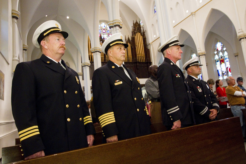 Portland Fire Department Deputy Chief William Flynn, from left, Chief Jerome LaMoria, Capt. John Cannon and Capt. Keith Gautreau attend the Blue Mass on Sunday.