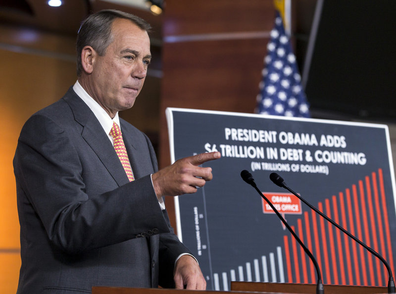 Speaker of the House John Boehner, R-Ohio, talks to reporters in Washington on Thursday about the fight over the budget on Capitol Hill as critical deadlines to fund the government loom.