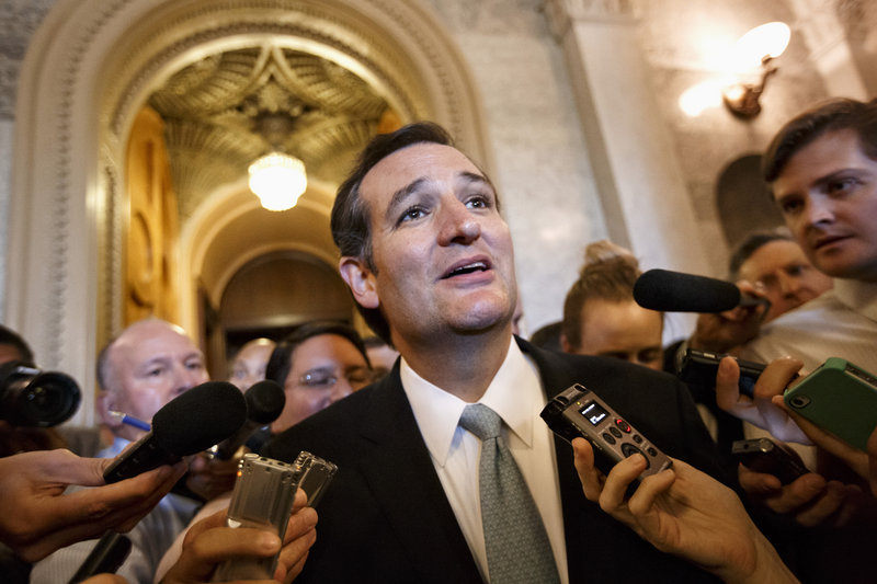 Sen. Ted Cruz, R-Texas, talks to reporters as he emerges from the Senate Chamber on Capitol Hill in Washington on Wednesday, after railing all night against the Affordable Care Act. A number of Republicans expressed disagreement with the senator's tactics.