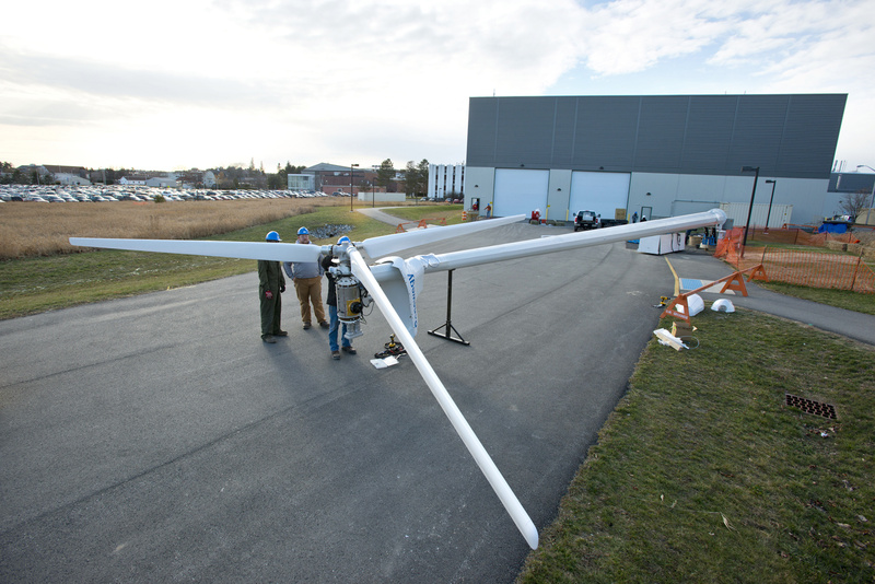 A team from the University of Maine at Orono tests a turbine outside their laboratory as they prepare to place the floating turbine in the ocean off the coast of Castine in May.