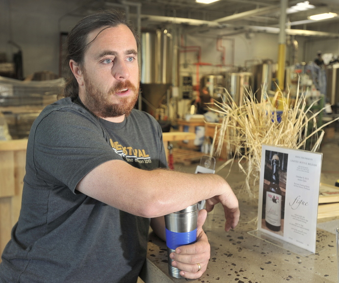 Nathan Sanborn, co-owner of Rising Tide Brewery in Portland, says the budget stalemate may slow federal approval of some of his new beer labels and delay sales.