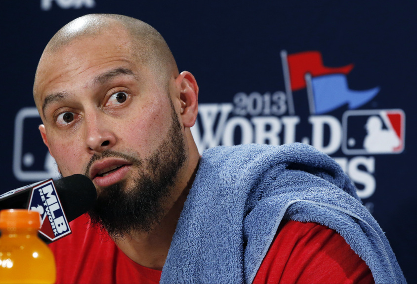 Boston Red Sox's Shane Victorino answers a question during a news conference before Game 6 of baseball's World Series against the St. Louis Cardinals Wednesday, Oct. 30, 2013, in Boston.