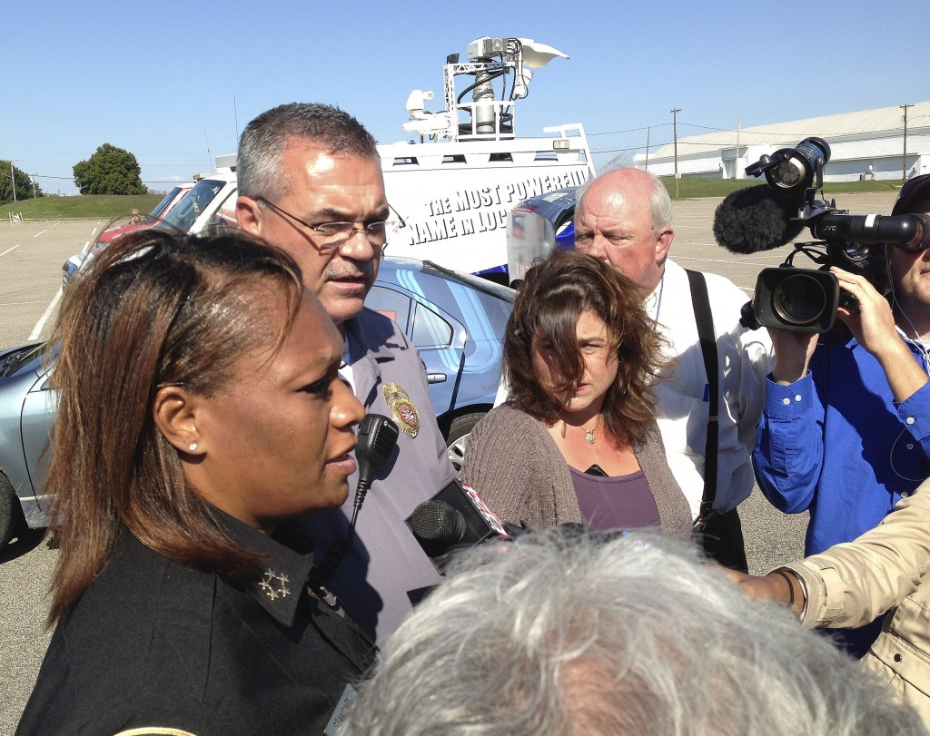 Police Chief Rita Stanback and Fire Chief Gary Graves, second from left, of Millington, Tenn., brief reporters about a shooting near a U.S. Naval Support Activity Mid-South on Thursday. The Navy said two soldiers were wounded, though neither had life-threatening injuries.